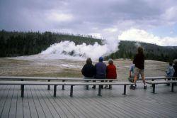 Visitors watching Old Faithful Photo