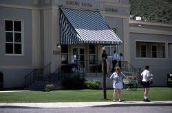 Visitors in front of Mammoth Hot Springs Hotel dining room Photo