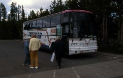 Visitors beside bus in the Canyon Village parking lot Photo