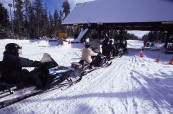Snowmobiles lined up at West entrance in the winter Photo