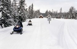 Snowmobiles at the South Entrance Photo