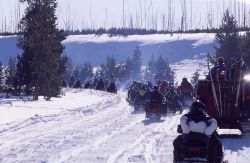 Snowmobiles & exhaust in the winter at the West entrance road on Presidents Day weekend Photo