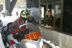 Snowmobile guide in the winter at the West entrance Photo