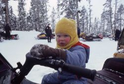 Child on snowmobile at Canyon in the winter Photo