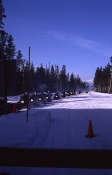 Line of snowmobiles waiting at West entrance in the winter Photo