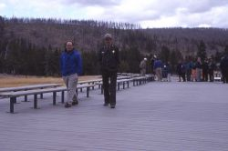 Assistant Superintendent Marv Jensen with Unilever representative on new plastic boardwalk at Old Faithful Photo