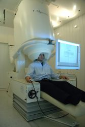 Patient performs a task in a MEG scanner Photo