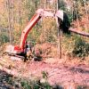 A crane places root wads in the channel that was constructed as a part of the restoration. Photo